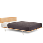 case study v-leg bed with cane headboard  -