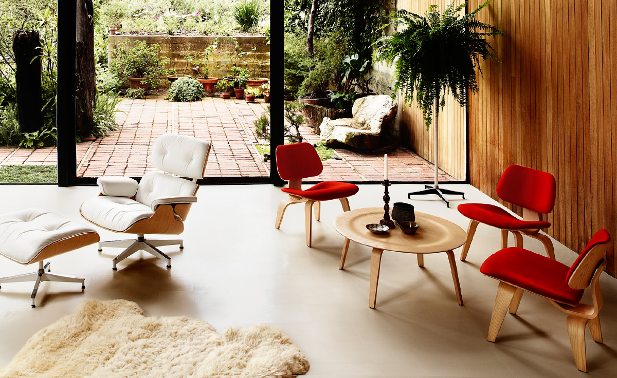 eames molded plywood coffee table with wood base - hivemodern